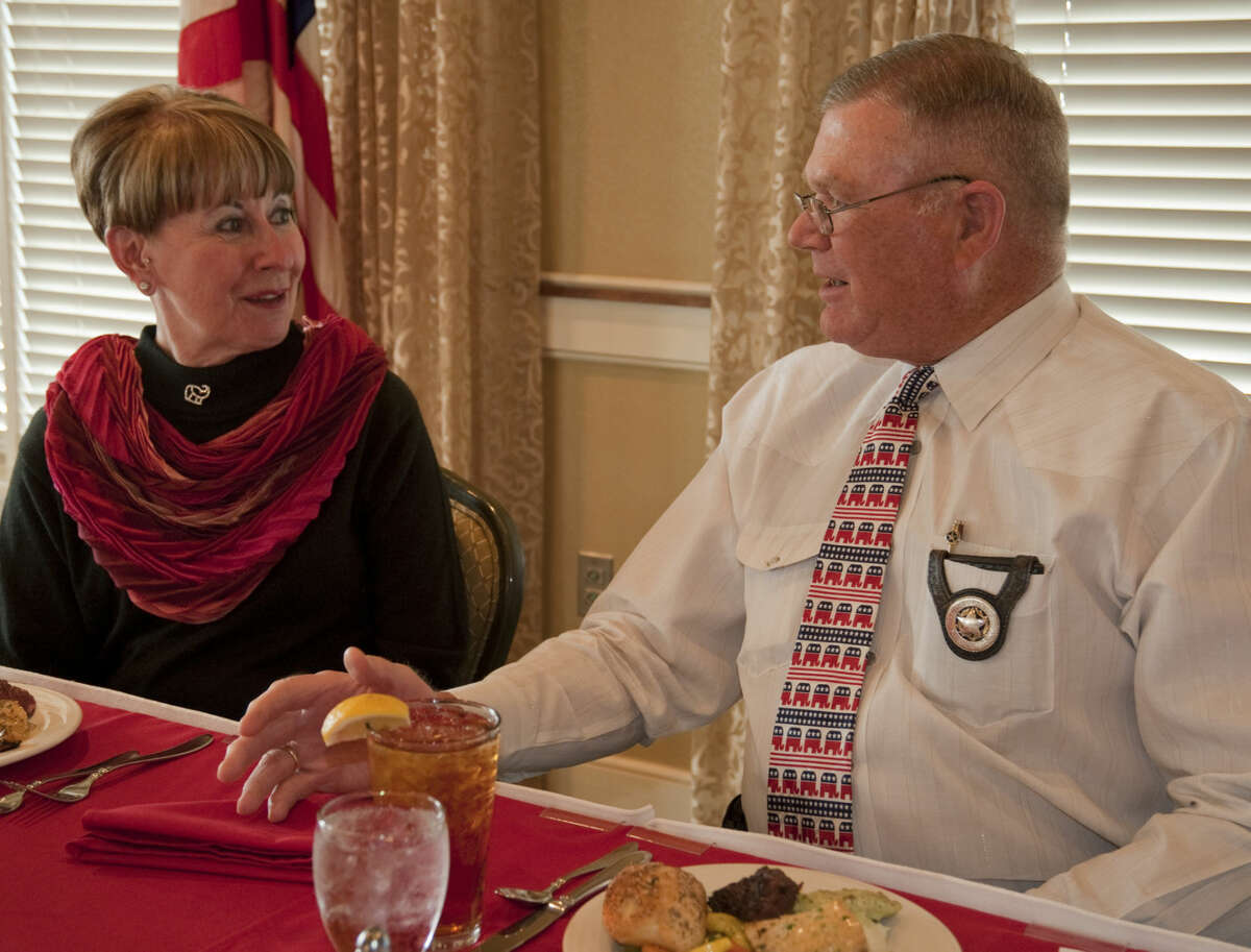 Cynthia Wallum talks with Sheriff Gary Painter in March before he spoke at the Midland County Republican Women's luncheon. Tim Fischer\Reporter-Telegram