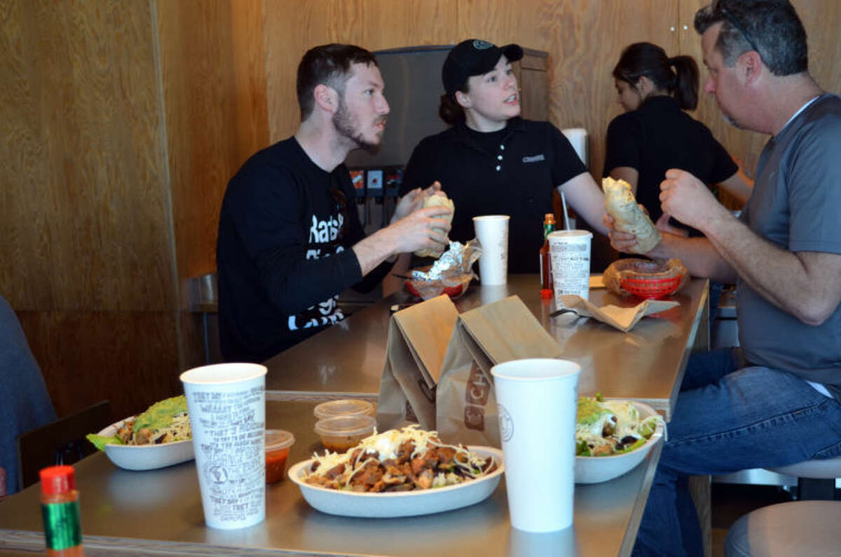 Chipotle Mexican Grill General Manager Nicole Russell chats with customers at the soft launch opening of the Midland store at the Commons at North Park. Russell is the GM for a San Antonio location and is in Midland to help with the grand opening Thursday.