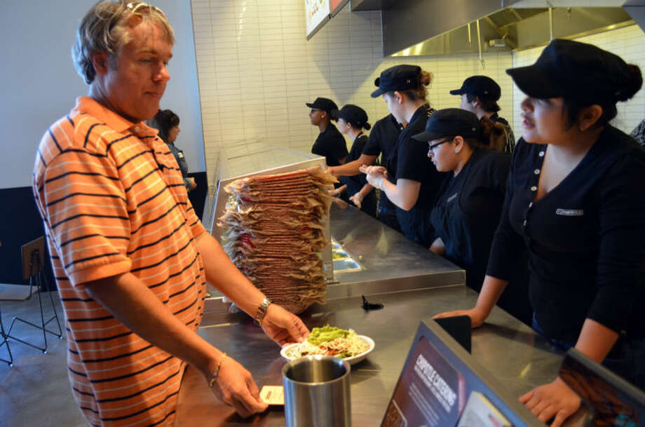 VIP customers sample Chipotle Mexican Grill's cuisine Tuesday during the soft opening of the new restaurant in the Commons at North Park. Chipotle is hosting another trial today ahead of its grand opening Thursday. Photo: James Cannon/MRT