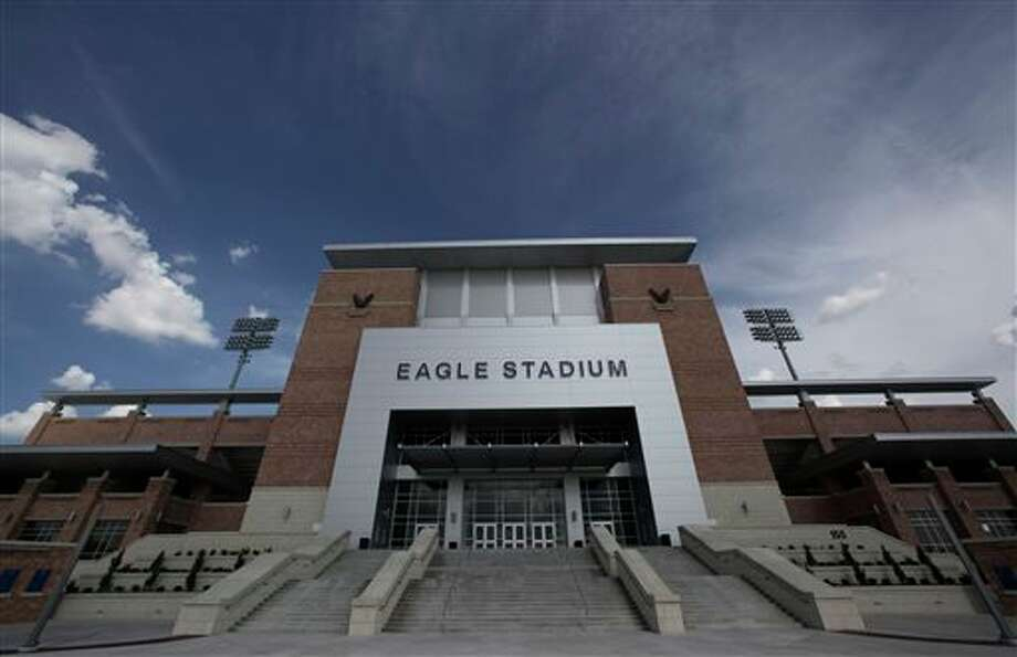 FILE - This Aug. 28, 2012 file photo shows the front entrance of Eagle Stadium at Allen High School in Allen, Texas. Fixing structural problems at Allen Eagle stadium may require demolishing major components, possibly in areas that include the athletic field, a preliminary forensics report says. (AP Photo/LM Otero, File) Photo: LM Otero / AP