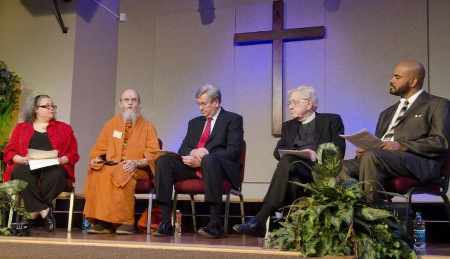 Rabbi Holly Levin Cohn from Temple Beth El in Odessa, Satguru Bodhinatha Veylanswami from Kauai's Hindu Monastery, the Rev. Randel Everett from First Baptist Church Midland, Monsignor James Bridges from St. Stephens's Catholic Church in Midland and Imam Wazir Ali from Houston Masjid of Al Islam, come together Feb. 28, 2012 for the second annual Interfaith Event at First Baptist Church in Midland. Each panelist submitted one question that the other panelists answered according to their faith practices. Photo by Tim Fischer/Midland Reporter-Telegram Photo: Tim Fischer