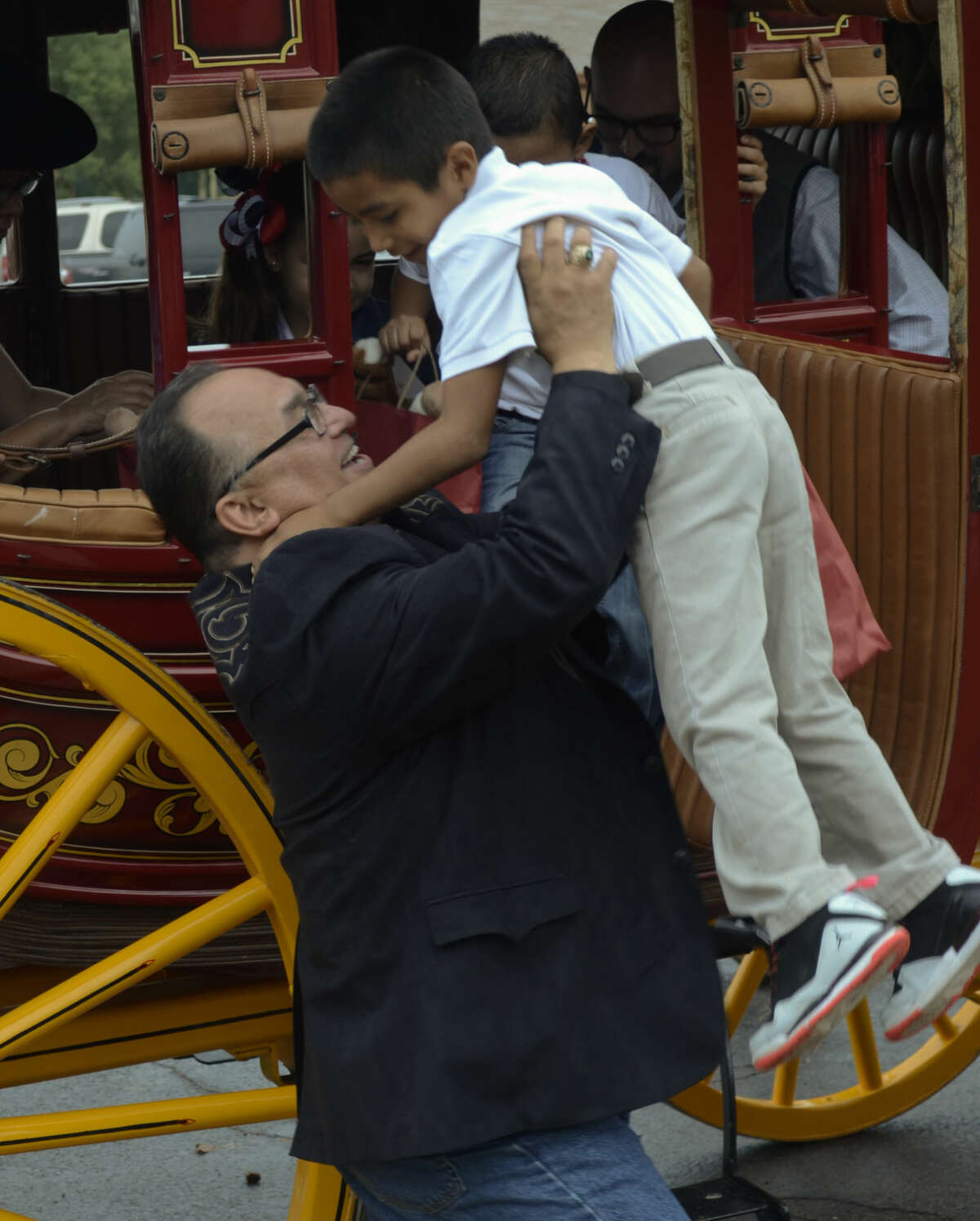 South Elementary Principal JR Silva helps lift students out of the Wells Fargo stage coach. Tim Fischer\Reporter-Telegram