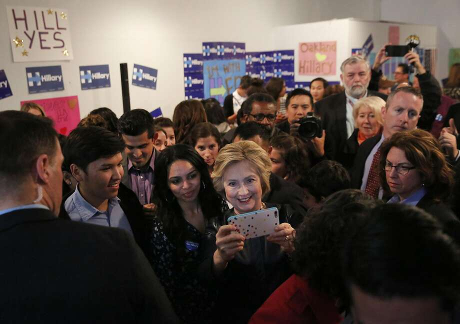 Democratic presidential candidate Hillary Clinton greets volunteers Friday at her newly opened campaign office in Oakland during a stop in the Bay Area. Photo: Leah Millis, The Chronicle