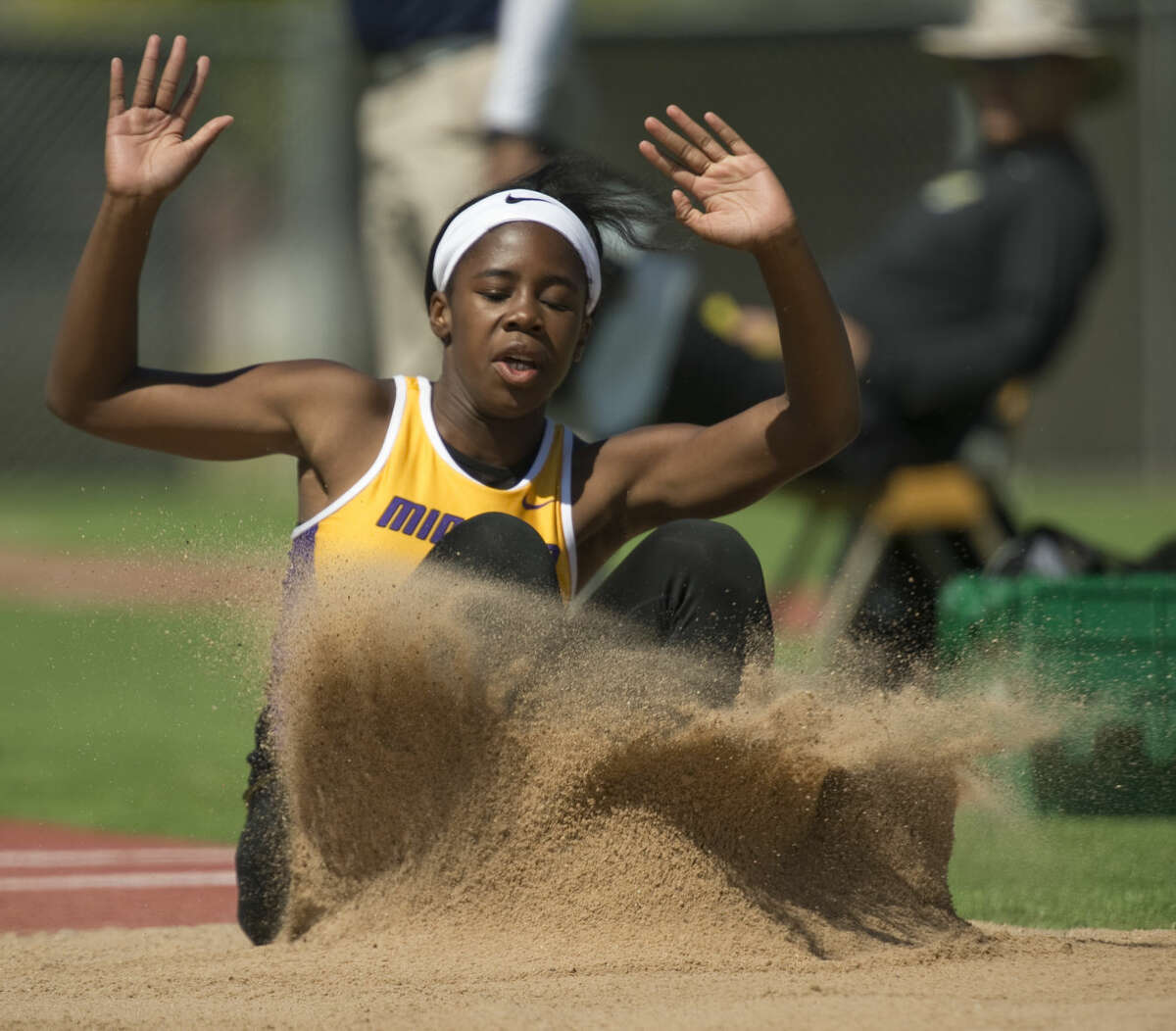 Midland High's Sametria Smith land in the pit on one of her triple jumps Thursday 04-14-16 in the District 3-6A Track and Field Championships at Ratliff Stadium. Tim Fischer\Reporter-Telegram