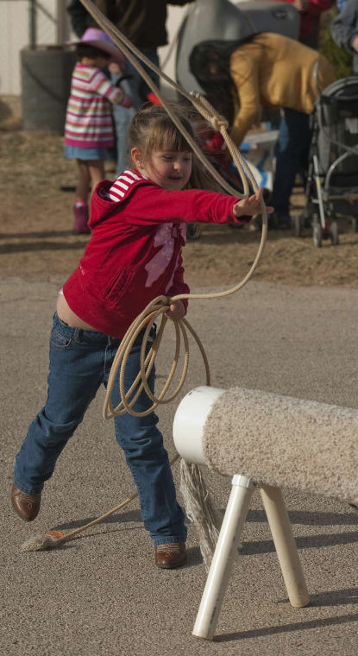 Alliie Jarvis practices roping a mechanical sheep Friday during Bynum School's Texas Independence Day celebration and rodeo fun day. Tim Fischer\Reporter-Telegram