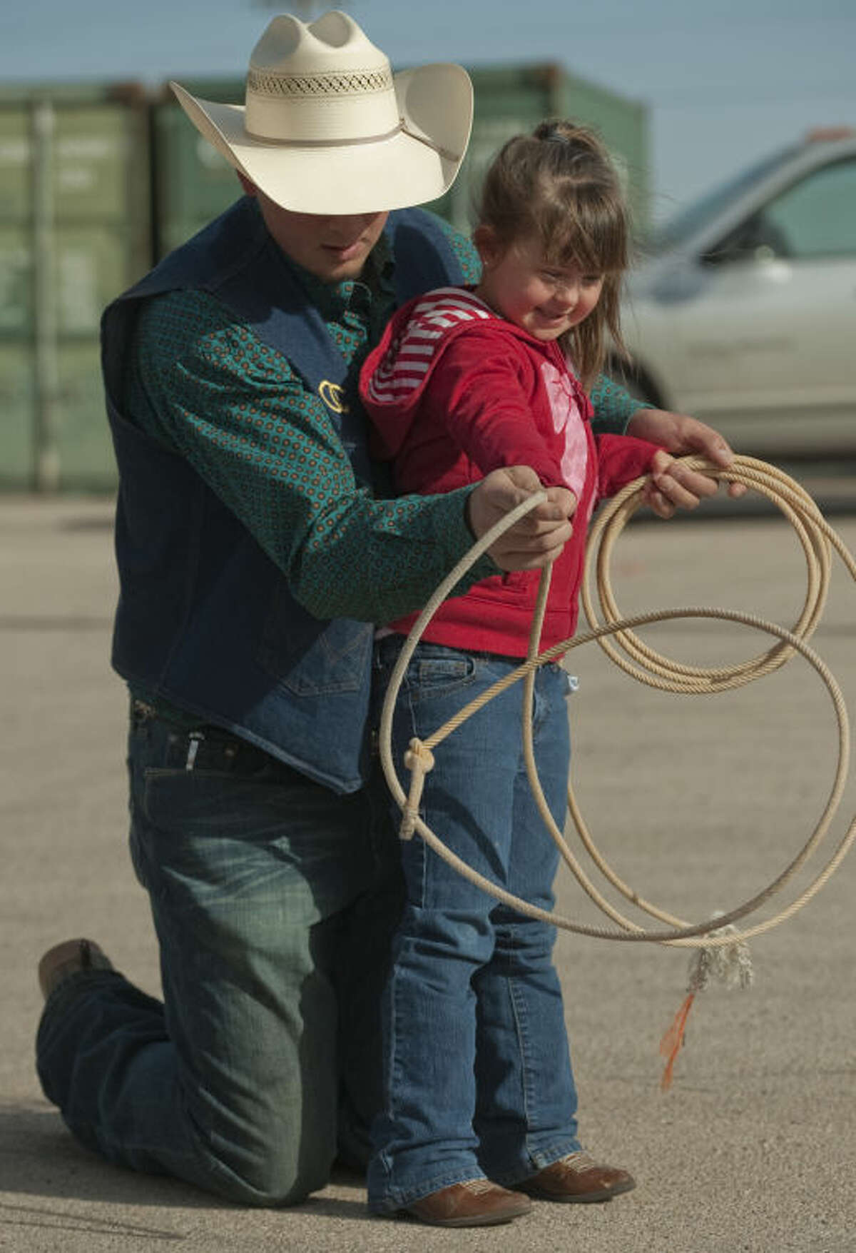 OC rodeo team member Brooke McFarland helps Allie Jarvis with some trick roping Friday during Bynum School's Texas Independence Day celebration and rodeo fun day. Tim Fischer\Reporter-Telegram