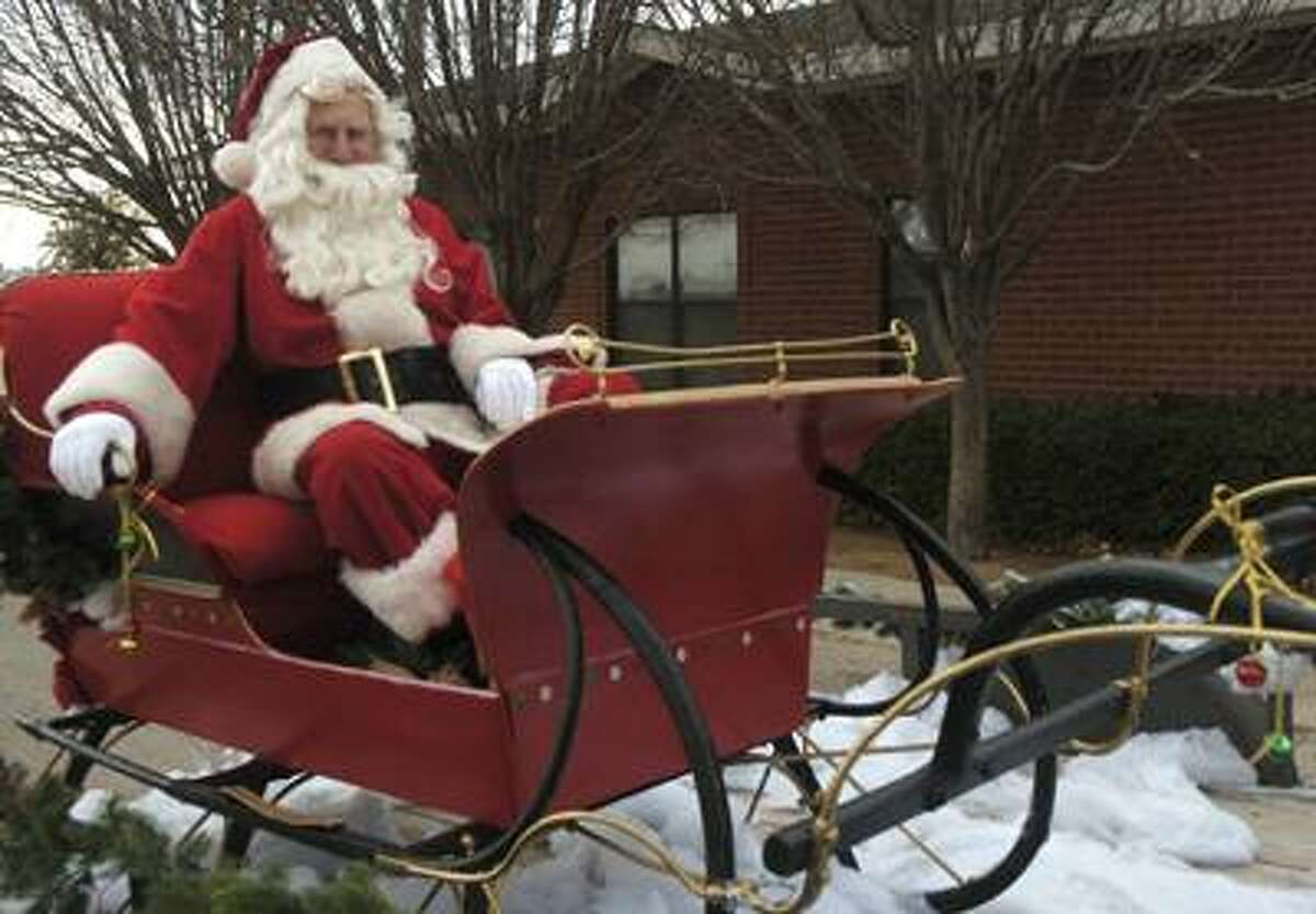 Santa, aka Victor Brenon, uses money he makes as Santa to buy toys for needy children. Photo by Tim Fischer 12\18\08