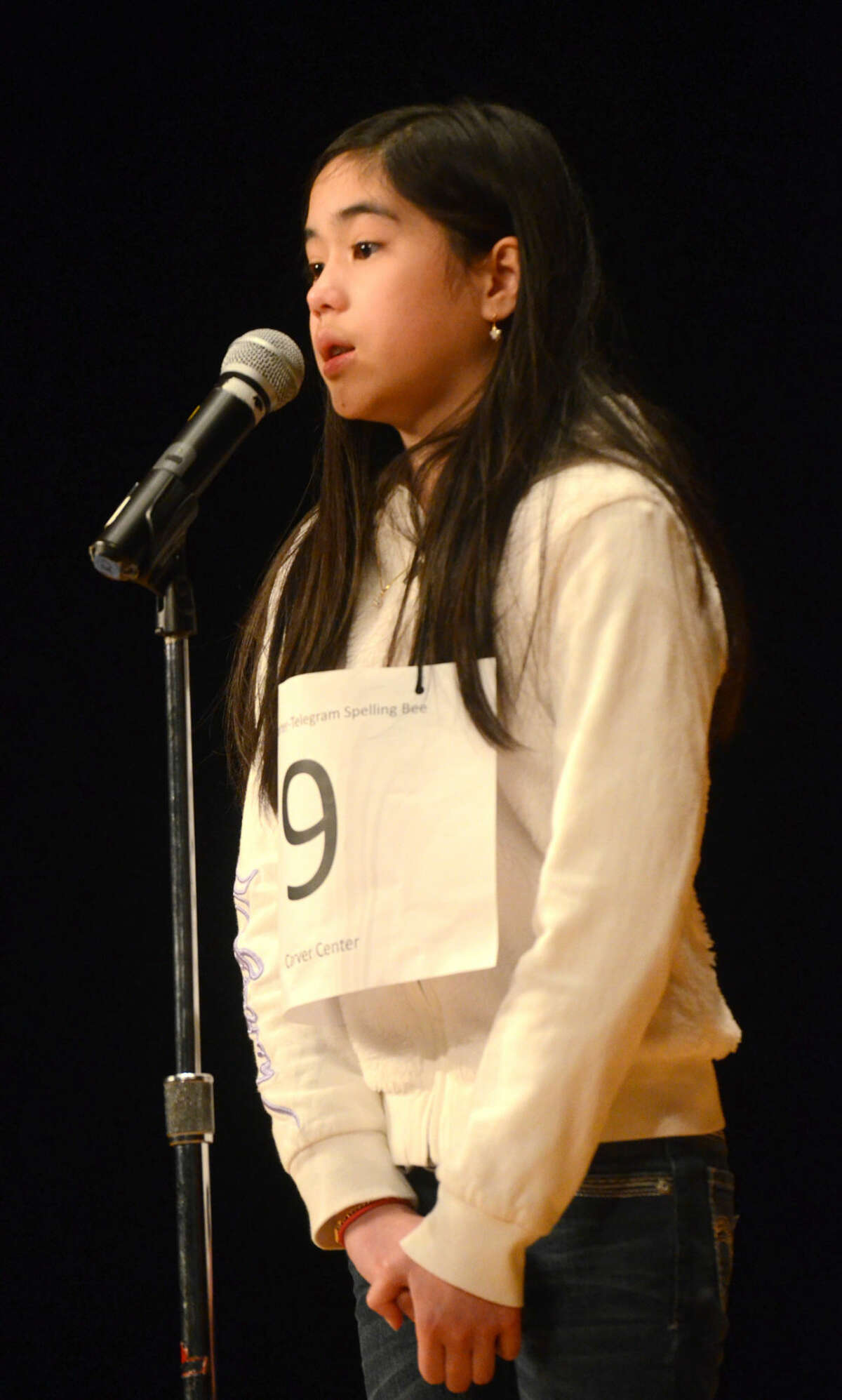 Anna Ngo of Carver competes in the Midland Reporter-Telegram regional spelling bee Saturday, March 21, 2015, in the Allison Fine Arts building on the campus of Midland College. James Durbin/Reporter-Telegram