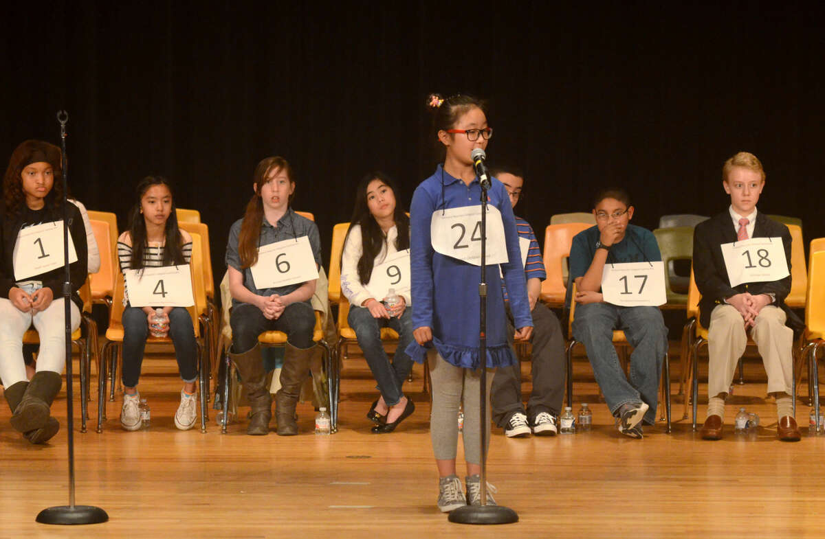 Lydia Lee of Midland Christian competes in the Midland Reporter-Telegram regional spelling bee Saturday, March 21, 2015, in the Allison Fine Arts building on the campus of Midland College. James Durbin/Reporter-Telegram