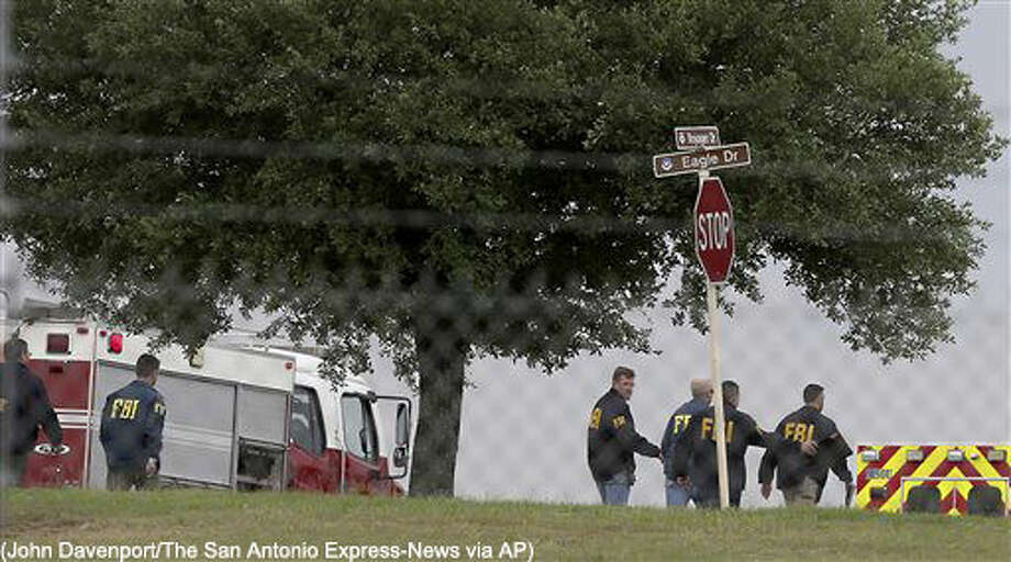 First responders and FBI agents gather near the scene of a shooting at Joint Base San Antonio-Lackland, Friday, April 8, 2016, in San Antonio. (John Davenport/The San Antonio Express-News via AP) RUMBO DE SAN ANTONIO OUT; NO SALES; MANDATORY CREDIT Photo: John Davenport