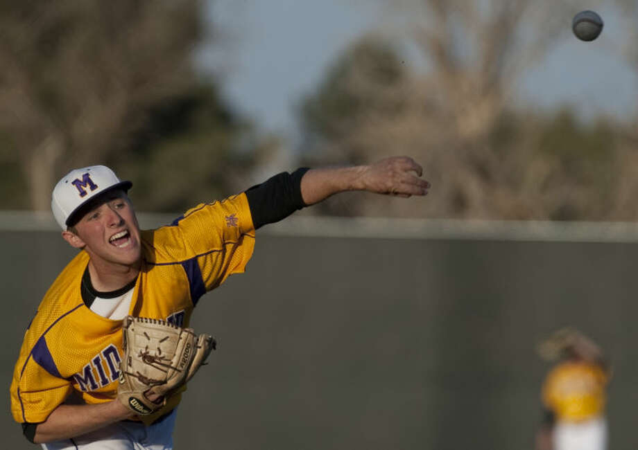 Midland High's Jackson Lancaster pitches against Lee Tuesday evening at Christensen Stadium. Tim Fischer\Reporter-Telegram Photo: Tim Fischer