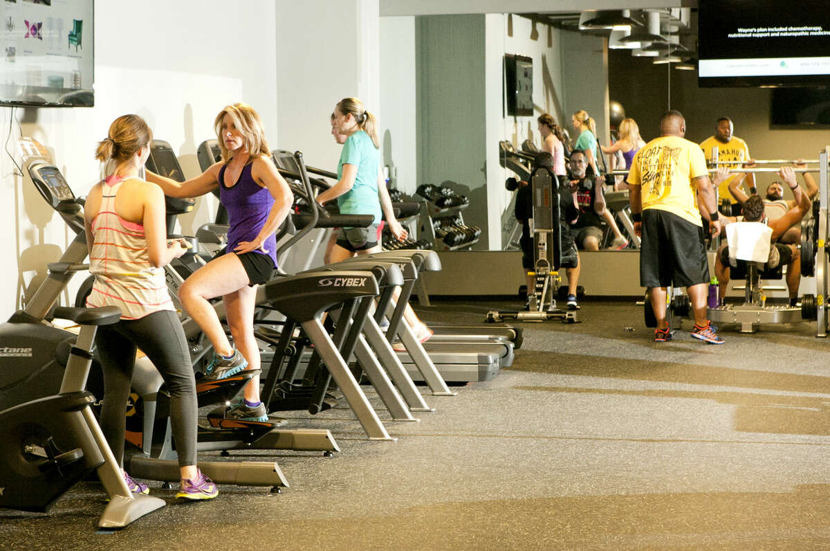 Many Pioneer employees use the lunch hour to complete a workout in one of the facility's two gyms. In addition to separate male and female locker rooms, Pioneer has co-ed and women only workout rooms. James Durbin/Reporter-Telegram