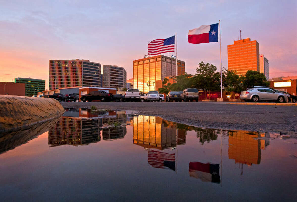 (File Photo) Sunset reflected in a rain puddle at the corner of W. Missouri and S. Carrizo Tuesday, May 14, 2013. James Durbin/Reporter-Telegram
