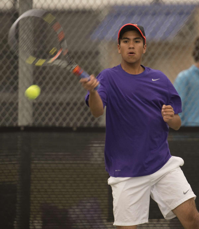 Midland High's Nick Martinez returns a shot Friday 04-08-16 during the championship match at the District 3-6A tournament at Bush Tennis Center. Tim Fischer\Reporter-Telegram