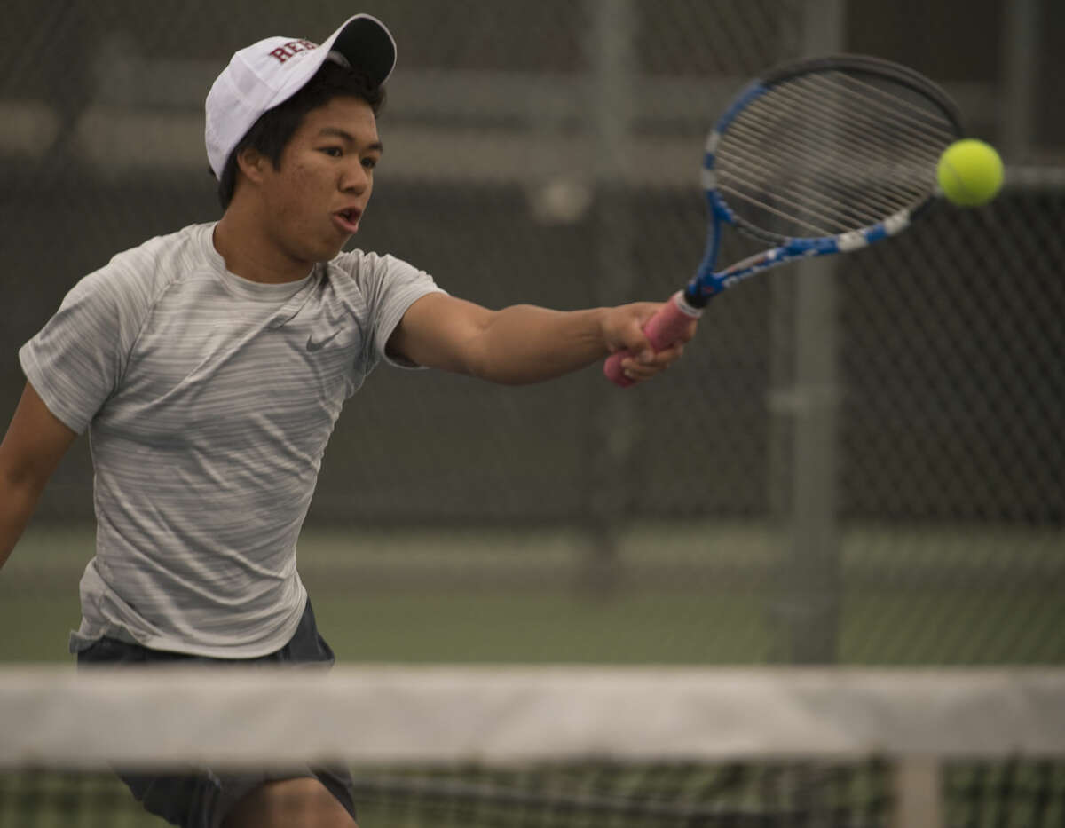 Midland Lee's Thomas Rubio returns a shot Friday 04-08-16 during the third place match at the District 3-6A tournament at Bush Tennis Center. Tim Fischer\Reporter-Telegram