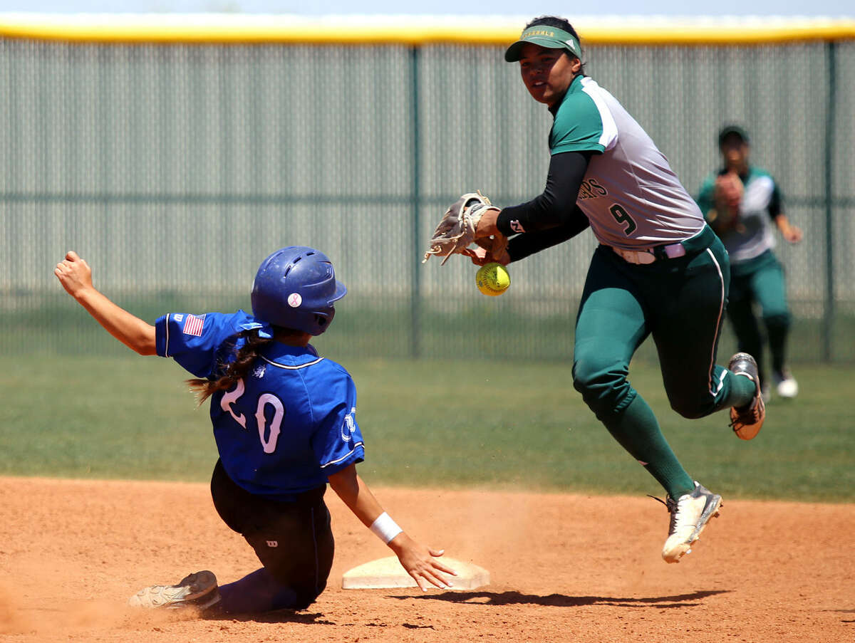 Midland College short stop Cassie Siataga loses the ball after tagging Odessa College's Jessica Gonzalez during the first double header game Saturday at the Midland College Softball Field.