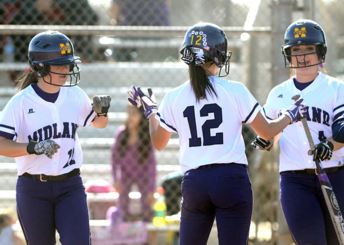Midland High's Aubree Rowley (11), Brittany Baggett (12) and Sydney Betcher (4) celebrate runs scored against San Angelo Central on Thursday at Audrey Gill Sports Complex. James Durbin/Reporter-Telegram