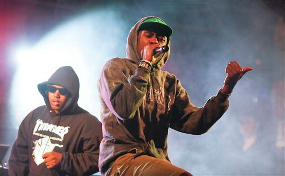 Tyler, The Creator, right, performs during the SXSW Music Festival early Friday, March 14, 2014, in Austin, Texas. (Photo by Jack Plunkett/Invision/AP) Photo: Jack Plunkett / Invision