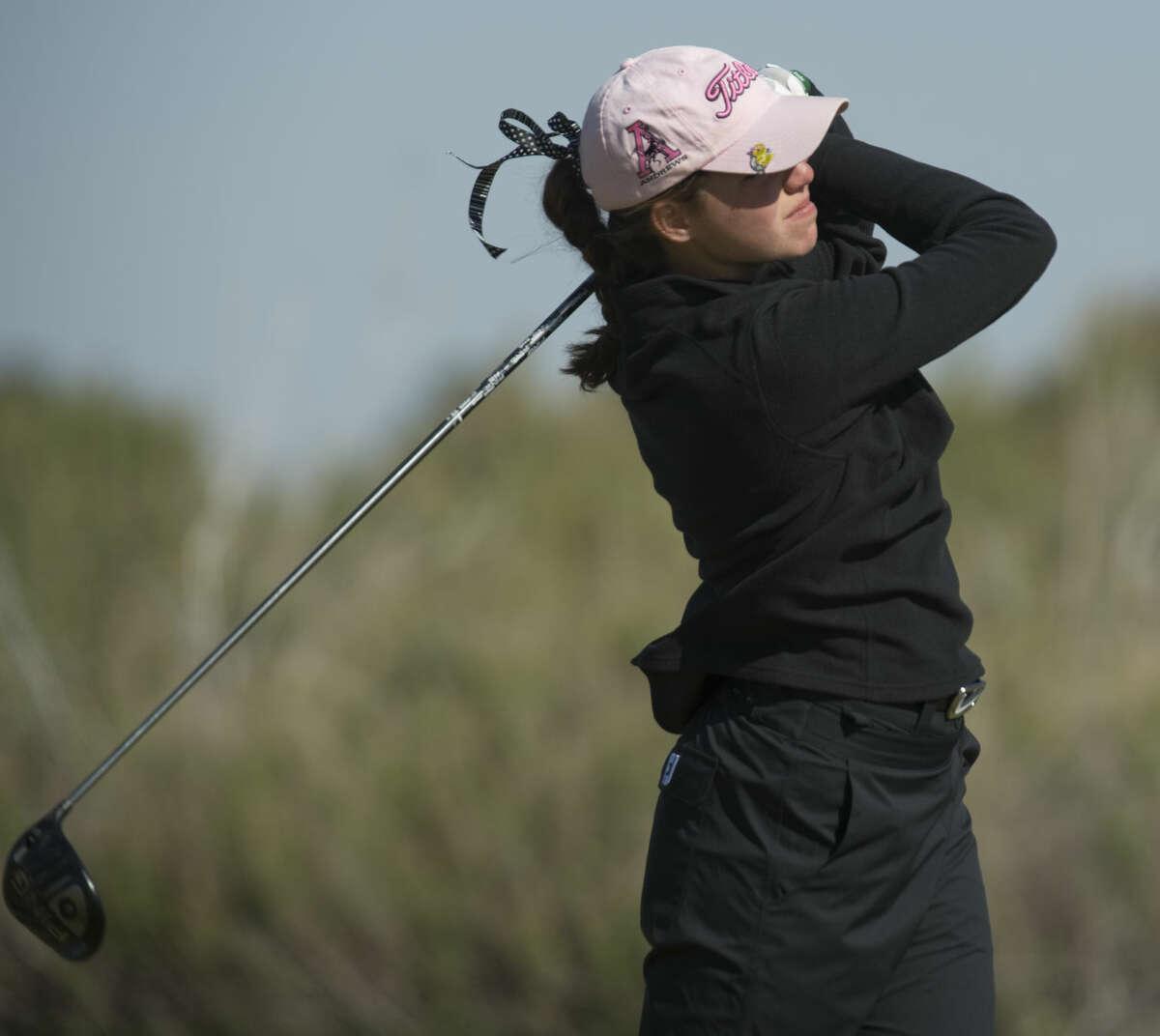Andrews' Libby Walinder follows her shot Monday 03-28-16 at the second round of the District 4-4A golf tournament at Hogan Park Golf Course. Tim Fischer\Reporter-Telegram