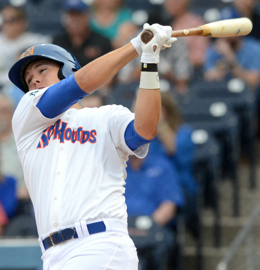Rockhounds' Ryon Healy swings against Northwest Arkansas during the season opener Thursday, April 9, 2015 at Security Bank Ballpark. James Durbin/Reporter-Telegram