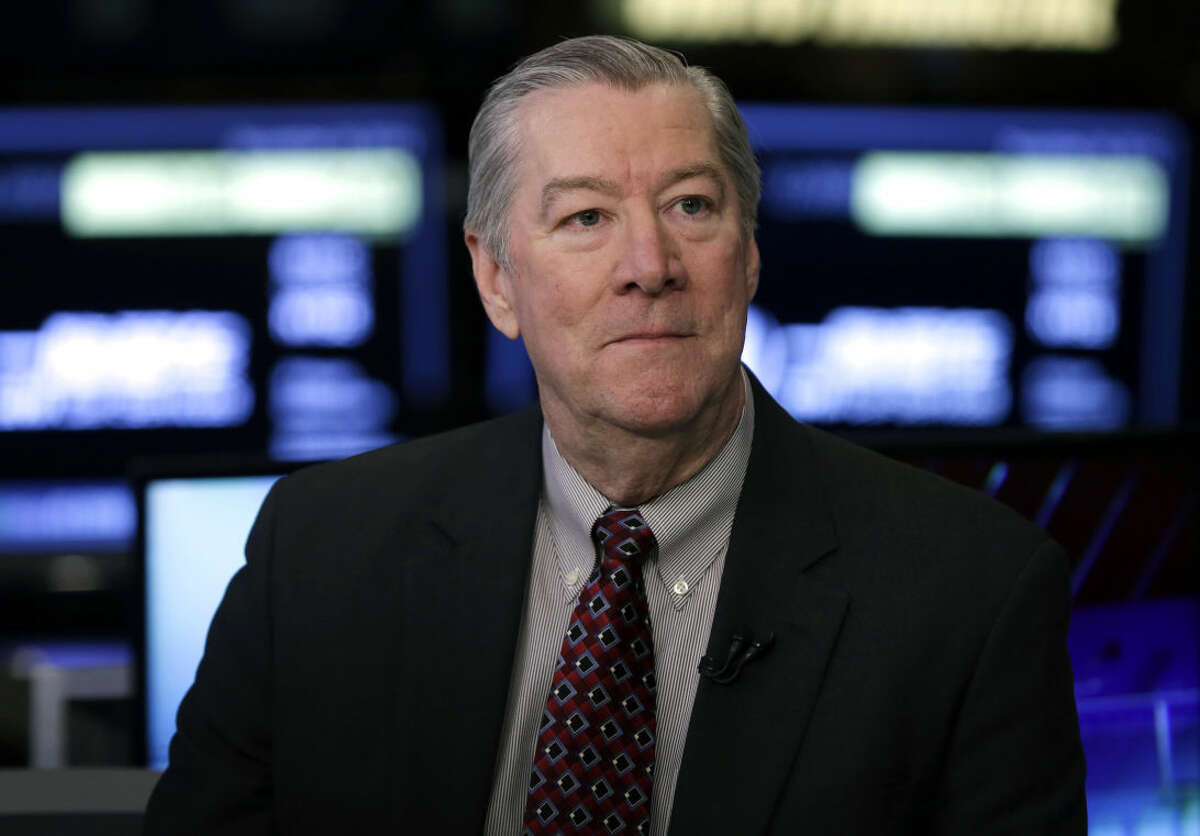 Chairman, President and CEO of Halliburton David Lesar, is interviewed at the New York Stock Exchange after ringing the opening bell, Tuesday, Nov. 18, 2014. (AP Photo/Richard Drew)