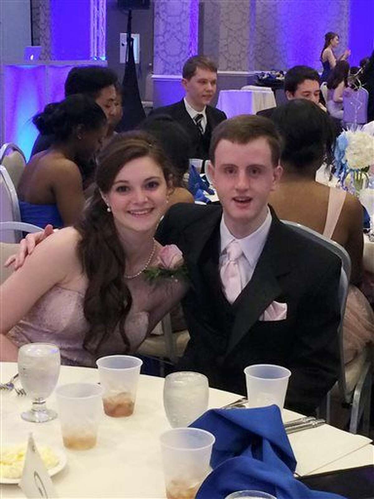 This March 28, 2015 photo provided by Kathty Lovetere shows Kaitlin McCarthy and Matty Marcone, students at Canton High School in Canton, Mass., at the school's junior prom. Kaitlin invited Matty, who has special needs, to be her date and they were crowned prom king and queen. Prom culture has changed so that some teens are now using the big night as a platform for social change and as an opportunity to be inclusive rather than exclusive. (Kathy Lovetere via AP)