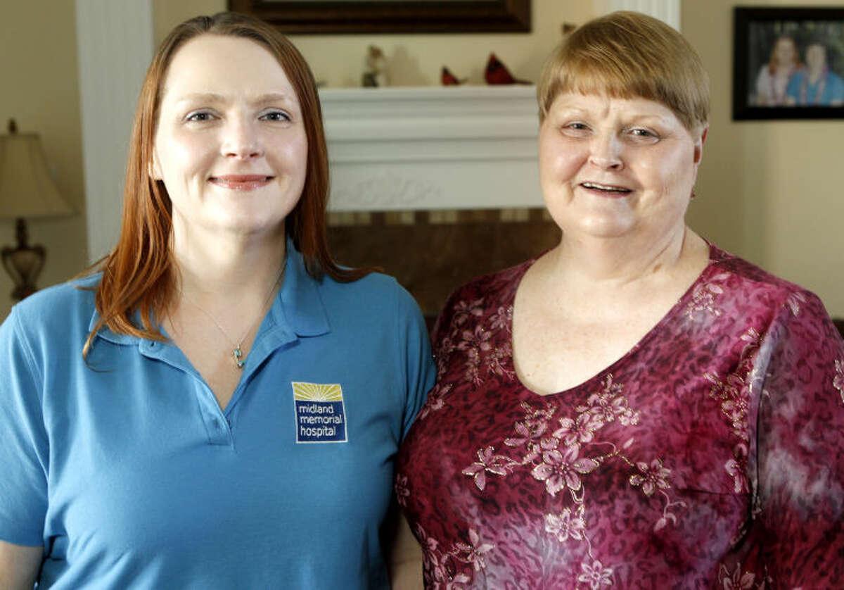 Kristi Podrazik (left) and her mother Bobbie (right) pose for a photo at Kristi's home Friday. James Durbin/Reporter-Telegram