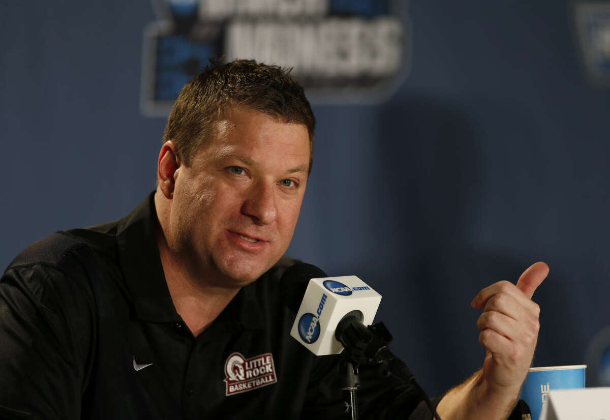 FILE - In this March 18, 2016 file photo, Arkansas Little Rock head coach Chris Beard responds to questions during a news conference as the team prepares for a second-round men's college basketball game in the NCAA Tournament in Denver. (AP Photo/David Zalubowski, File)