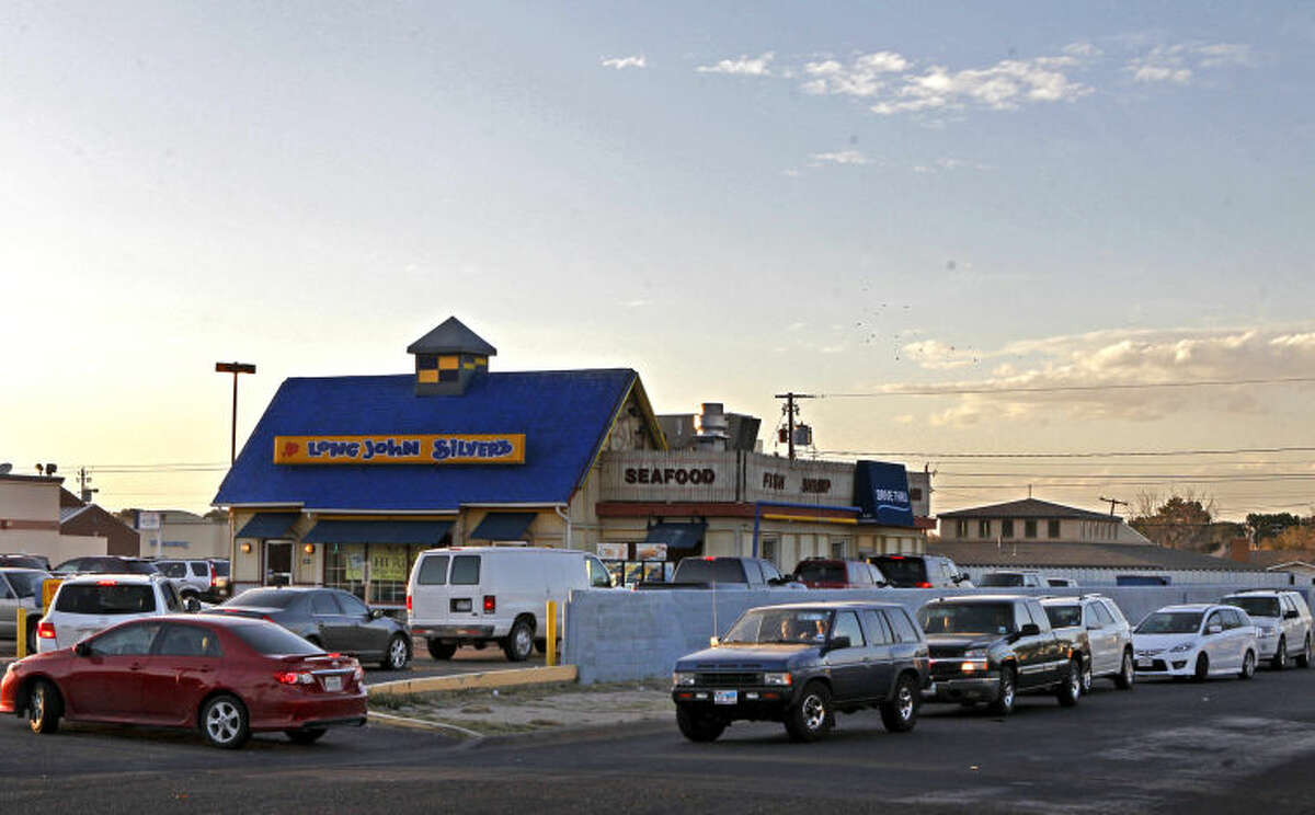 The line for the drive-through at Long John Silver's wraps around the building and north on Ward Street on Friday. James Durbin/Reporter-Telegram