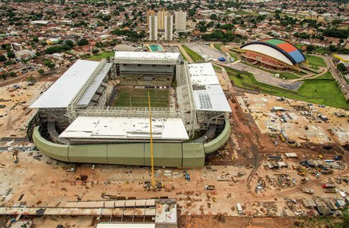 This Jan. 10, 2014 photo released by Portal da Copa shows an aerial view of the Arena Pantanal in Cuiaba, Brazil. Brazil isn't alone among nations whose preparations for the Cup came under fire. South Africa, the last host, had serious security problems and delivered many works related to the tournament at the last moment. But Brazil is in worse shape, with FIFA President Sepp Blatter saying earlier this year that the country was further behind than any host he had dealt with during his four decades at the world governing body, despite having more time to prepare. (AP Photo/Portal da Copa, Jose Medeiros)