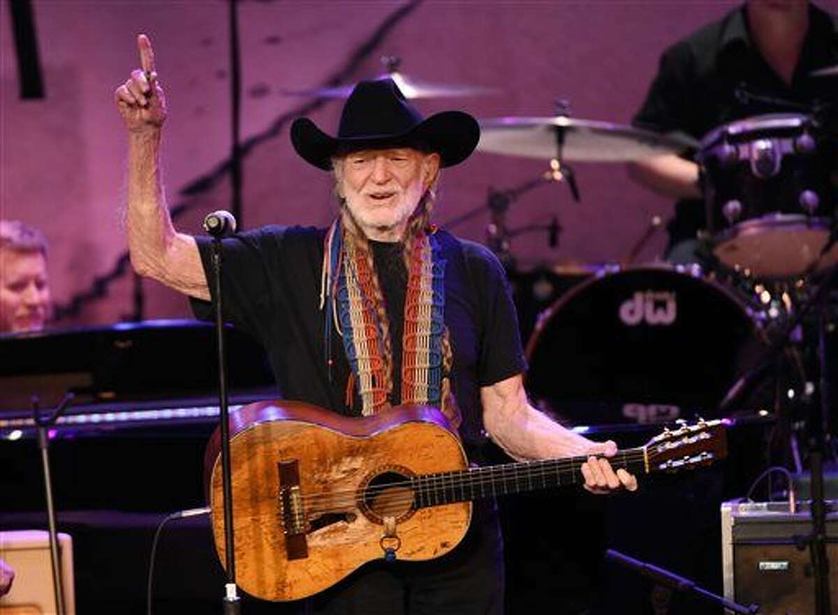 FILE - In this Feb. 5, 2015 file photo, Willie Nelson performs at the 17th Annual GRAMMY Foundation Legacy Concert at the Wilshire Ebell Theatre in Los Angeles. Nelson announced Monday, April 20, 2015, he plans to roll out his own brand of marijuana called ``Willie's Reserve,'' that will be grown and sold in Colorado and Washington, two states where recreational use of the drug is legal. (Photo by Chris Pizzello, file/Invision/AP)