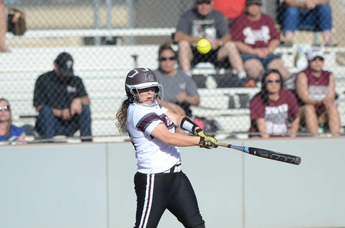Lee High's Sarah Welsh hits against Abilene High on Tuesday, March 24, 2015 at Gene Smith Field. James Durbin/Reporter-Telegram