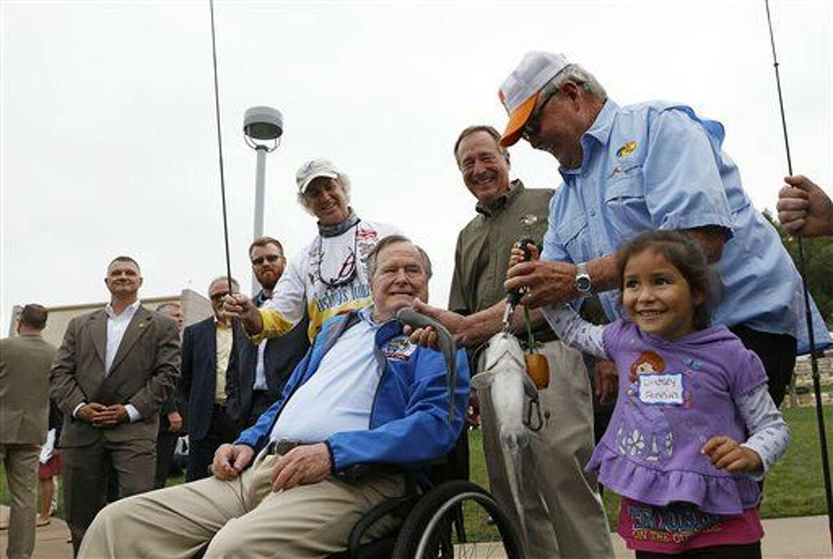 IMAGE DISTRIBUTED FOR RBFF - President George H.W. Bush, center, fishes with local children during a Recreational Boating & Fishing Foundation (RBFF) event at the George Bush Presidential Library on Thursday, April 14, 2016, in College Station, Texas. RBFF is a nonprofit organization whose mission is to increase participation in recreational angling and boating, thereby protecting and restoring the nation's aquatic natural resources. (Aaron M. Sprecher/AP Images for RBFF)