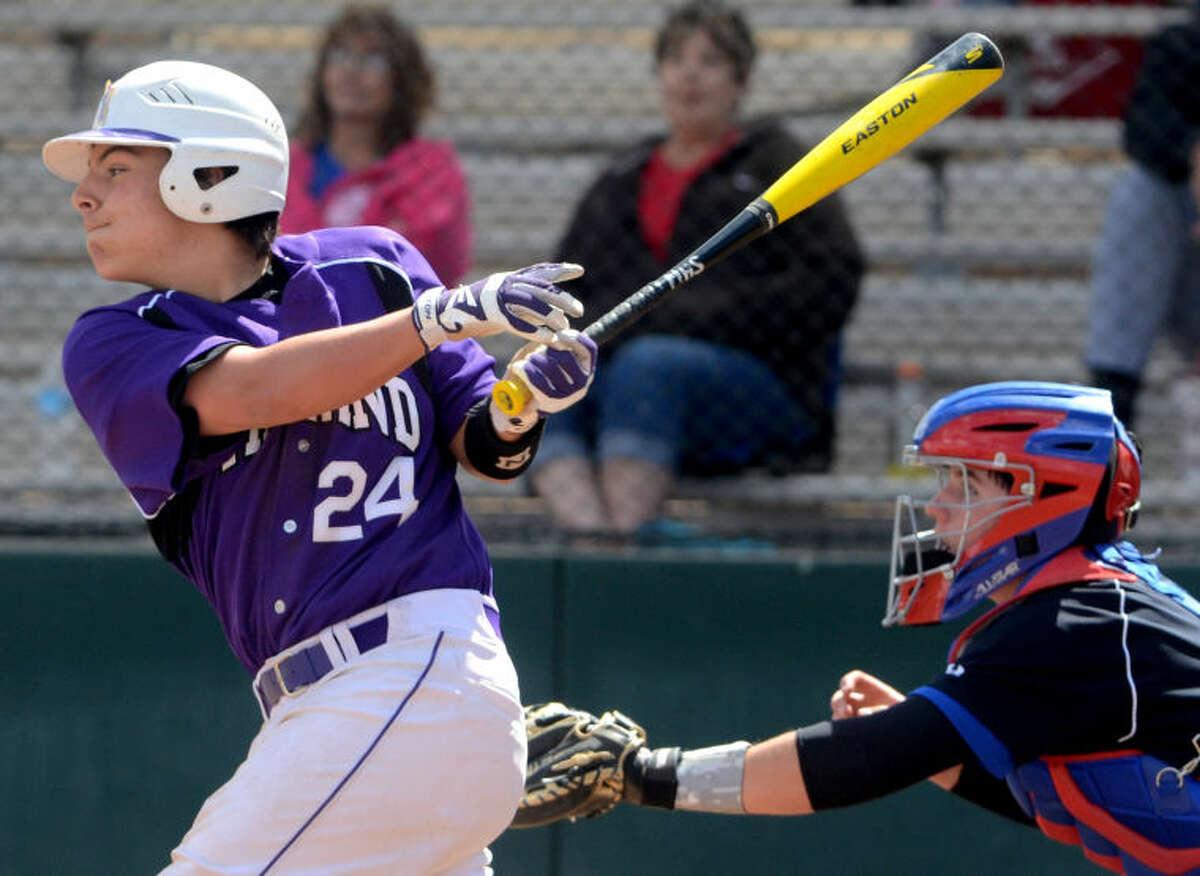 Midland High's Bradon Scrivner hits against Abilene Cooper on Saturday at Zachery Field. James Durbin/Reporter-Telegram