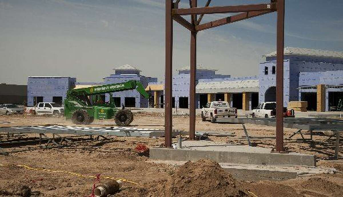 Construction continues Monday, 4-20-15, on the Borgata retail center at Loop 250 and Holiday Hill Road.Tim Fischer\Reporter-Telegram