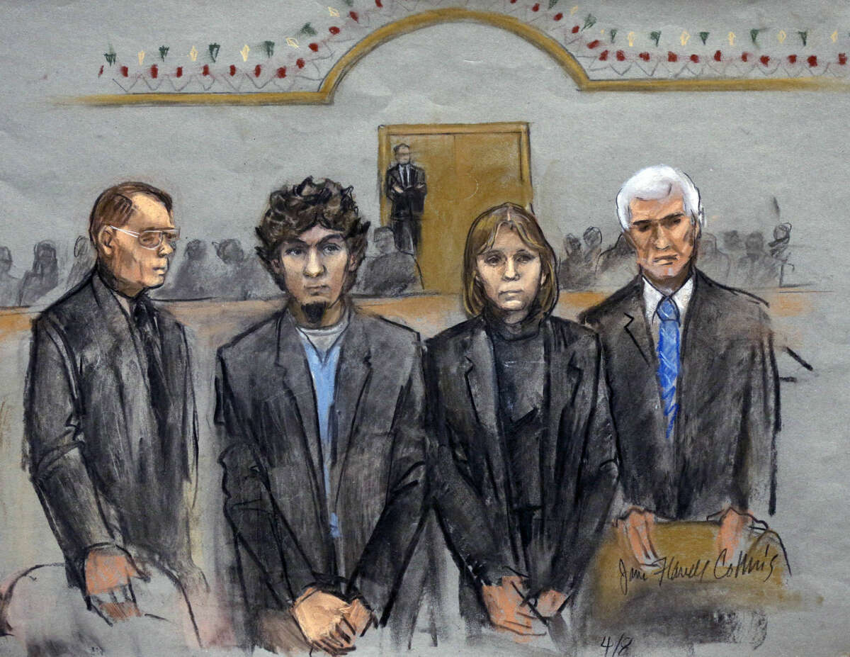 In this courtroom sketch, Dzhokhar Tsarnaev, second from left, is depicted standing with his defense attorneys as the jury presents its verdict in his federal death penalty trial Wednesday, April 8, 2015, in Boston. Tsarnaev was convicted on multiple charges in the 2013 Boston Marathon bombing. Three people were killed and more than 260 were injured when twin pressure-cooker bombs exploded near the finish line. (AP Photo/Jane Flavell Collins)