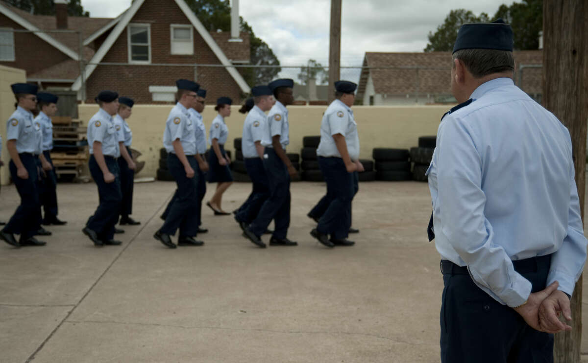 US Air Force Col. Wolfgang Gesch inspects the MHS JrROTC cadets marching Tuesday, 4-14-15 outside MHS. Tim Fischer\Reporter-Telegram