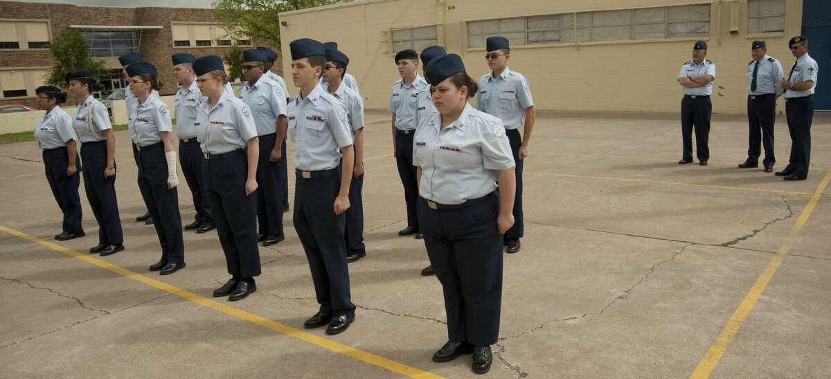 US Air Force Col. Wolfgang Gesch, back center, with Maj Donald Speir (Ret. USAF), left, and MSgt Alex Chick (Ret. USAF) inspects the MHS JrROTC cadets marching Tuesday, 4-14-15 outside MHS. Tim Fischer\Reporter-Telegram