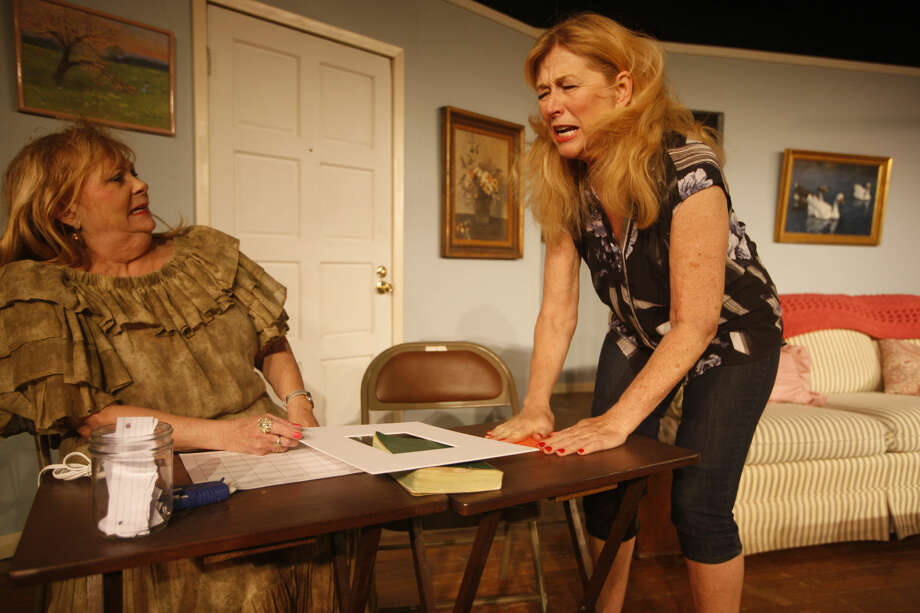 """Cindy Oglesby, left and Paula Waldrop perform in Maverick Players production of """"The Red Velvet Cake War"""" which runs through April 24. Photo: James Durbin"""