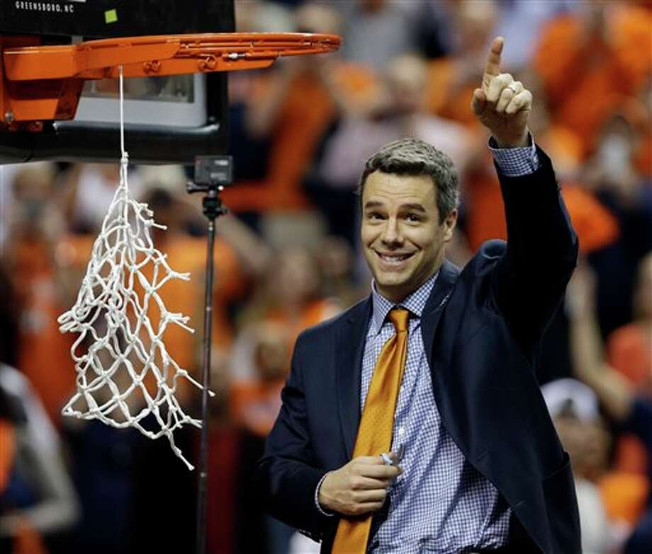 Virginia head coach Tony Bennett celebrates after defeating Duke in an NCAA college basketball game in the championship of the Atlantic Coast Conference tournament in Greensboro, N.C., Sunday, March 16, 2014. Virginia won 72-63. (AP Photo/Gerry Broome) Photo: Gerry Broome / AP