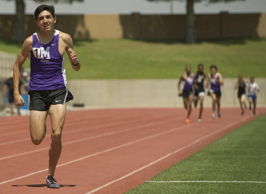Midland High's Bryce Hoppel leaves the field behind to win the boys 800m run Friday 04-15-16 at the District 3-6A track championships at Ratliff Stadium. Tim Fischer\Reporter-Telegram