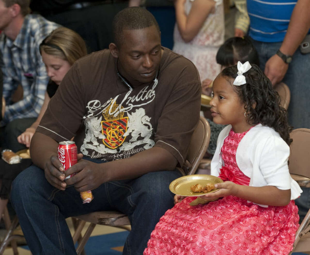 Kendrick Arnett and his daughter Kyndra take a break and get some snacks Thursday evening at the Father-Daughter dance at Henderson Elementary. Tim Fischer\Reporter-Telegram