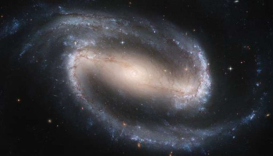 This image made by the NASA/ESA Hubble Space Telescope shows the barred spiral galaxy NGC 1300. It is considered to be prototypical of barred spiral galaxies. The Hubble Space Telescope marks its 25th anniversary. A full decade in the making, Hubble rocketed into orbit on April 24, 1990, aboard space shuttle Discovery. (NASA/ESA, Hubble Heritage Team STScI/AURA via AP) Photo: HOGP