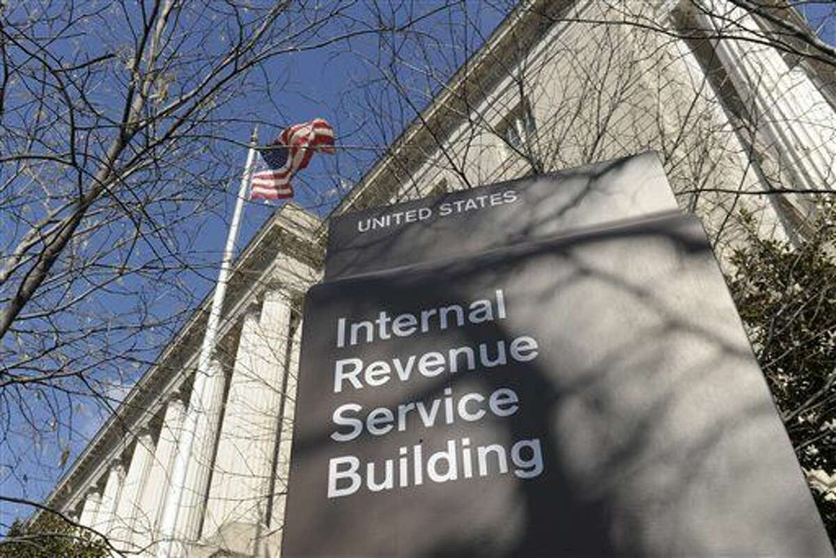 FILE - This March 22, 2013, file photo, shows the exterior of the Internal Revenue Service building in Washington. The IRS' overloaded phone system hung up on more than 8 million taxpayers in the 2015 filing season as the agency cut millions of dollars from taxpayer services to help pay to enforce President Barack Obama's health law. (AP Photo/Susan Walsh, File)
