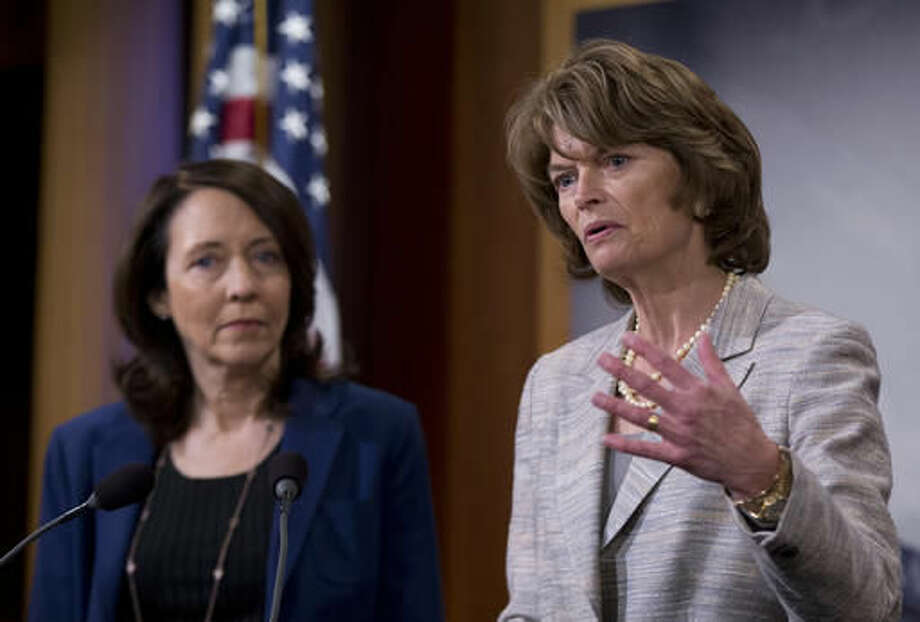 Senate Energy and Natural Resources Committee Chair Sen. Lisa Murkowski, R-Alaska, right, accompanied by the committee's ranking member, Sen. Maria Cantwell, D-Wash., speak about energy policy modernization during a news conference on Capitol Hill in Washington, Wednesday, April 20, 2016. The Senate approved a wide-ranging energy bill Wednesday, April 20, 2016, that would promote a variety of energy sources and speed federal approval of projects to export liquefied natural gas to Europe and Asia. (AP Photo/Manuel Balce Ceneta) Photo: Manuel Balce Ceneta