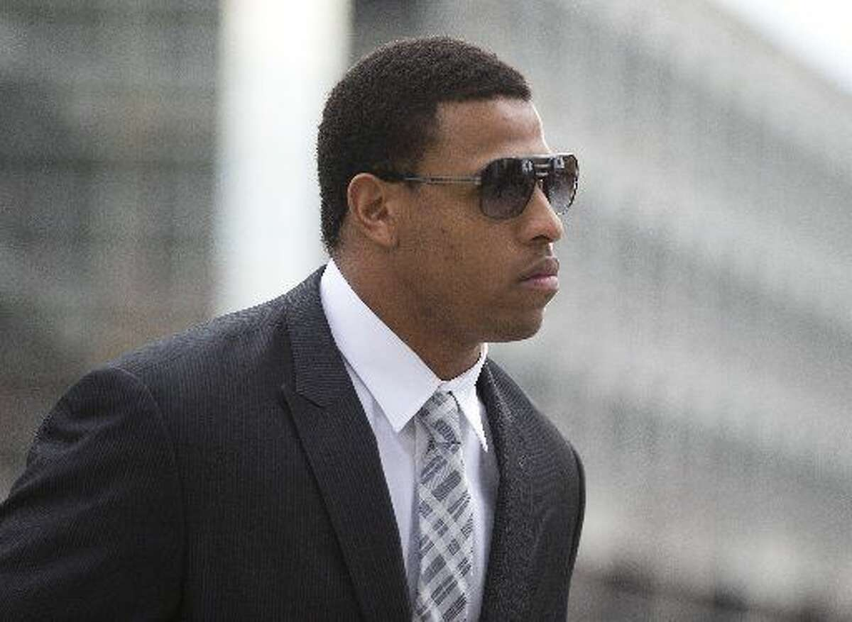 In this Feb. 9, 2015, file photo, Carolina Panthers' defensive end Greg Hardy arrives at the Mecklenburg County Courthouse on the first day of his domestic violence appeal trial in Charlotte, N.C. The NFL, on Wednesday, April 22, 2015, suspended Hardy, now with the Dallas Cowboys, for 10 games for conduct detrimental to the league.Hardy, who joined the Cowboys as a free agent this year, plans to appeal. (AP Photo/Chris Keane, File)