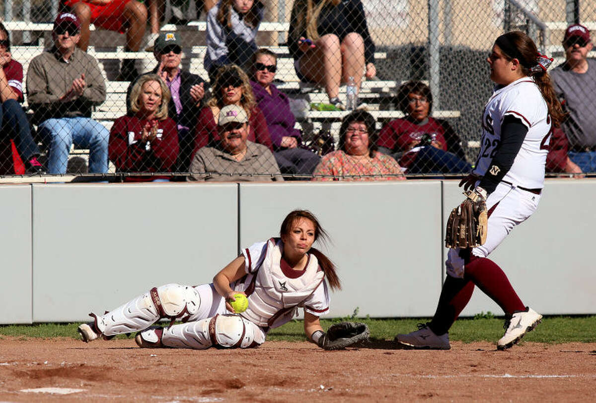Midland Lee's Cid Martin rushes over to help catcher Destiny Reyes as she attempted to catch a foul ball during the 4-1 win over Permian Thursday at the Gene Smith Field.