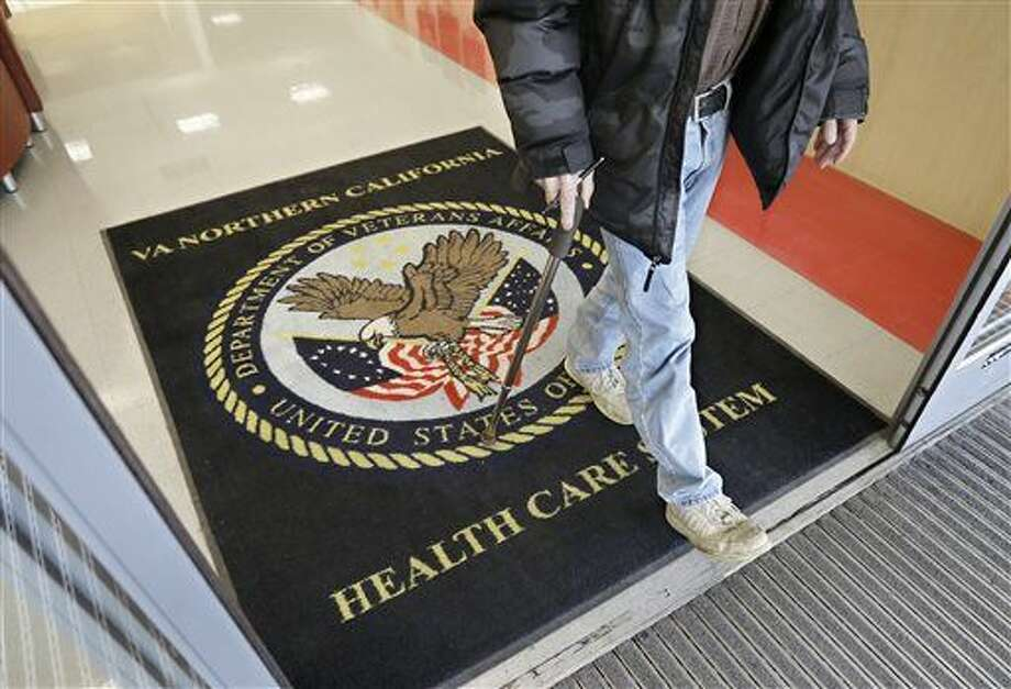 FILE - In this April 2, 2015, file photo, a visitor leaves the Sacramento Veterans Affairs Medical Center in Rancho Cordova, Calif. A new program that was supposed to get patients off waiting lists at Veterans Affairs medical centers by letting them switch to private-sector doctors is proving to be an even bigger disappointment than initially thought. (AP Photo/Rich Pedroncelli, File) Photo: Rich Pedroncelli