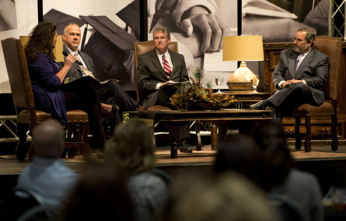 Laura Roman, left, asks questions to the panel discussion members, Mark Palmer, Rick Davis and Chris Coxon Tuesday 04-19-16 duing the State of Education luncheon. Tim Fischer\Reporter-Telegram