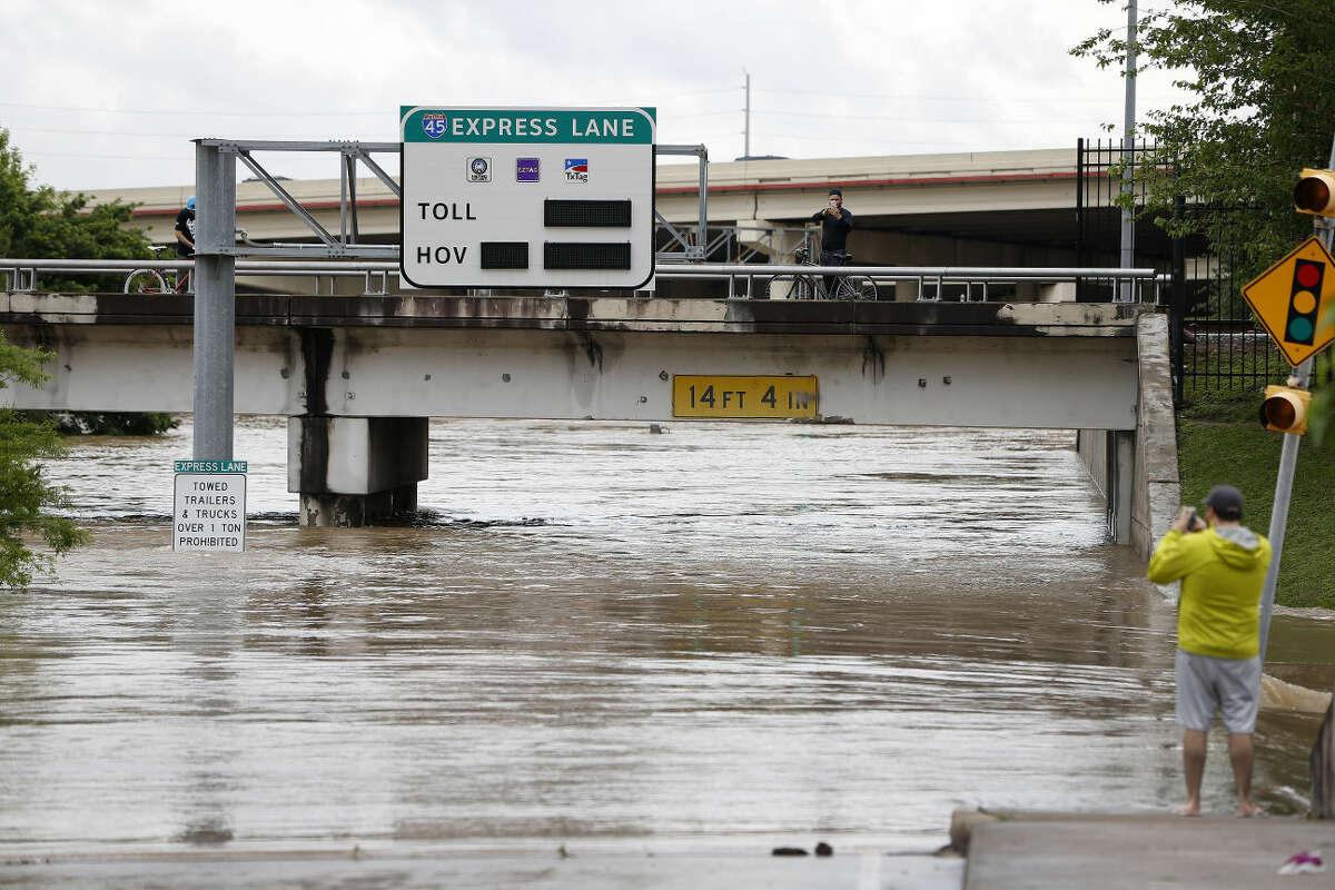 Flood waters from the Buffalo Bayou fill up on Louisiana Street near the University of Houston Downtown, Monday, April 18, 2016, in Houston. ( Karen Warren / Houston Chronicle )